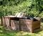 Wooden compost bin lid in situ